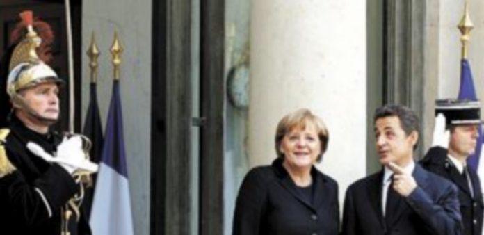 Angela Merkel y Nicolas Sarkozy quieren que el nuevo acuerdo entre en vigor el próximo mes de marzo. / Reuters.