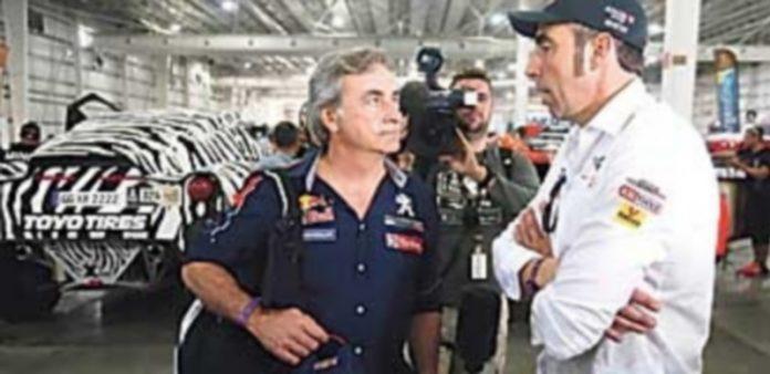 Carlos Sainz (i) y Nani Roma (d) se hicieron con la victoria en coches en las ediciones de 2010 y 2014