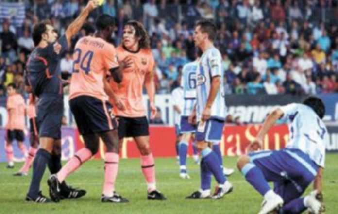 La baja de Alves hará que Puyol actúe como el lateral derecho del Barça