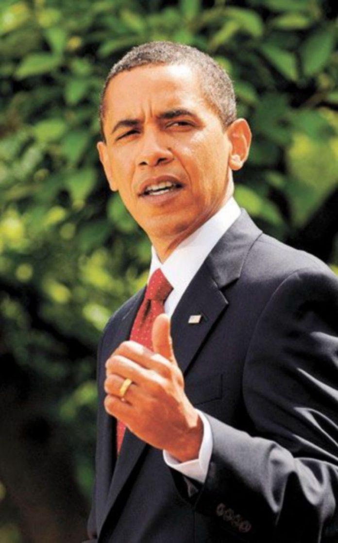 El presidente de EEUU durante la firma de la ley. / EFE