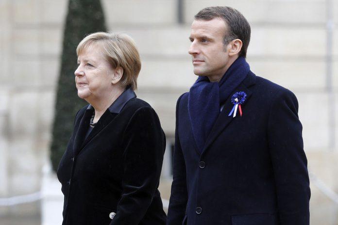 El presidente de Francia, Emmanuel Macron, junto a la canciller alemana, Angela Merkel, representantes de las dos potencias enfrentadas durante la I Guerra Mundial.