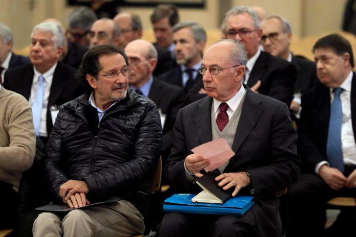 El expresidente de Bankia Rodrigo Rato (dcha) junto al exconsejero de Caja Madrid José Antonio Moral Santín (izq).