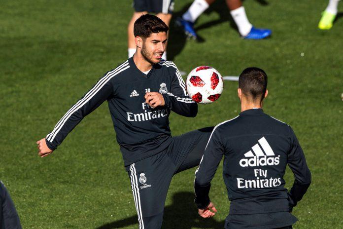 Marco Asensio, uno de los jugadores que ha perdido peso con la llegada de Solari, en el entrenamiento de ayer