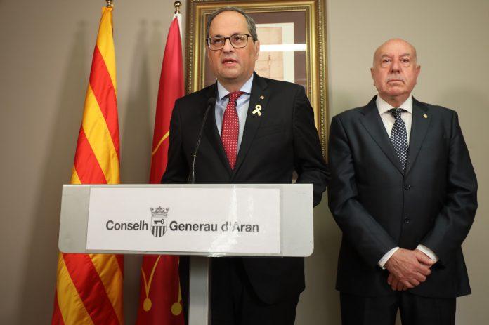 El presidente catalán, Quim Torra, junto al síndic de Aran, Carlos Barrera.