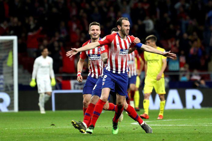 El defensa uruguayo del Atlético de Madrid Diego Godín celebra su gol anotado ante el Girona.