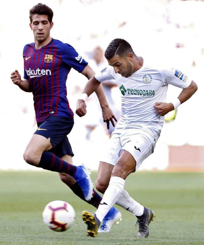 Ángel Rodríguez controla el balón durante el Barça-Getafe del domingo.